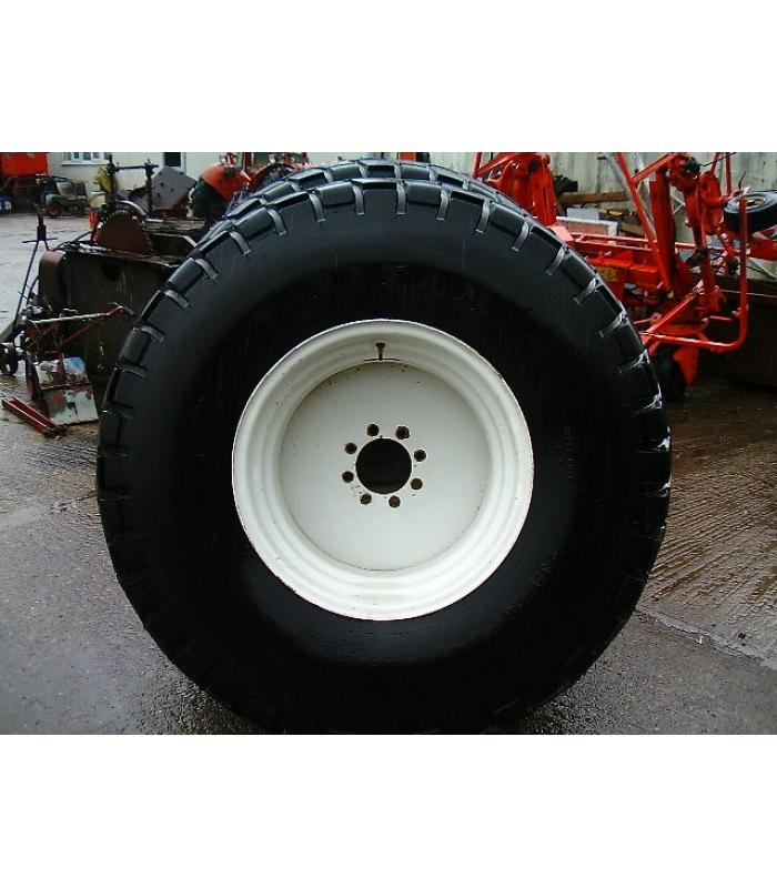 Pair of Titan 23.1 x 26 Grassland Tyres on New Holland Wheels